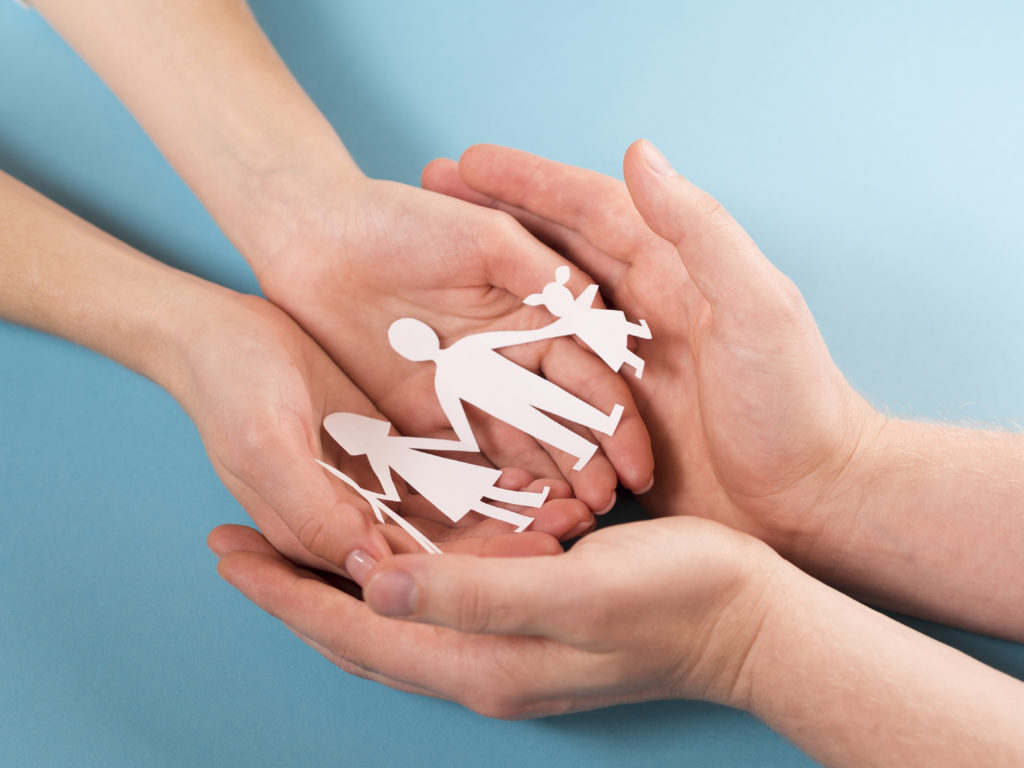 people-holding-in-hands-cute-paper-family